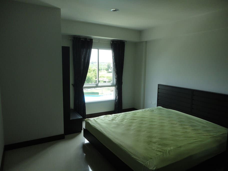Good sized bedroom with king size bed and pool view