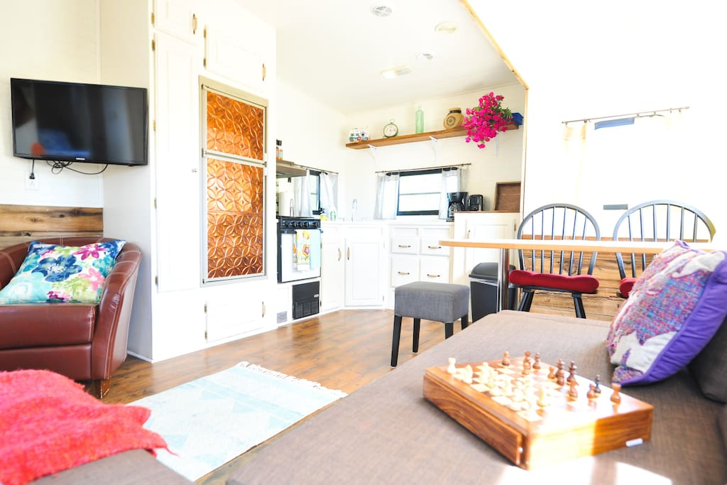Your kitchen and dining area - we've left some board games for you and DVDs are available upon request