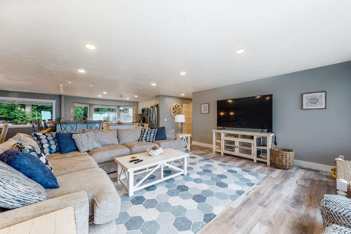 Dog-friendly home w/ canal views, a large game room, furnished deck, & patio