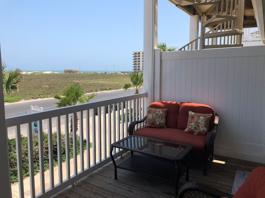 Our second story deck is furnished with a lounge chair plus seating for four people. There is a beautiful view of the dunes and Gulff  across the street.