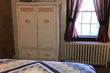 First floor bedroom has a flat panel TV on the wall with cable channels. Beautiful armoire to help you unpack. Bedroom is carpeted.