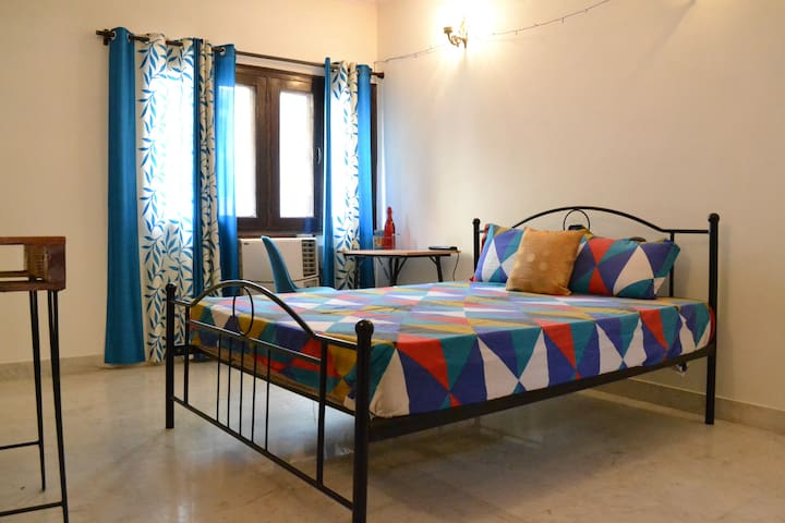 Private room with Bed and Spring Mattress for your comfortable stay. Window which a perfect daylight in the room.  Study Table and a Chair also available.