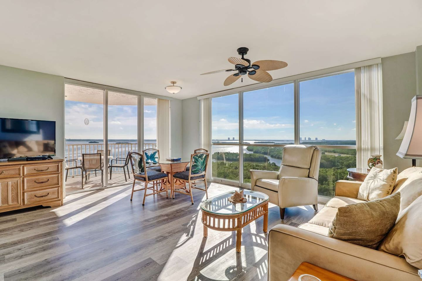 View from the floor to ceiling windows throughout the living area bring the natural beauty of southwest Florida right into your vacation space!