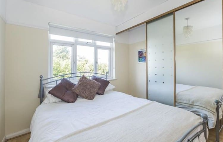Private room lovely large 4 bedroomed house.