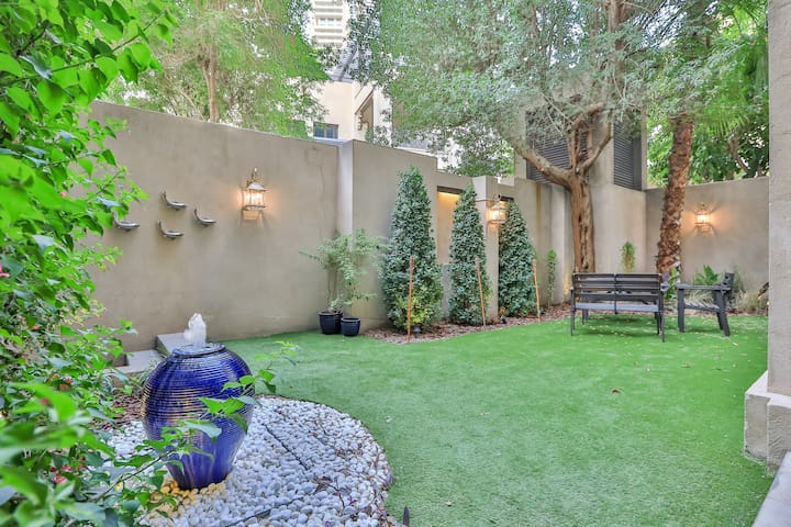 Private Garden 1BR with Burj View at Yansoon2