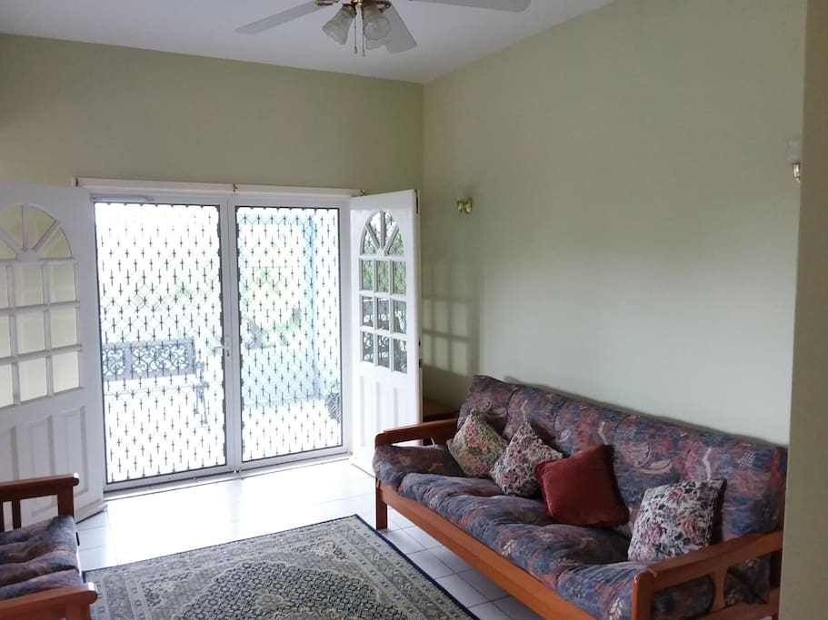 Living area with french doors and screened doors