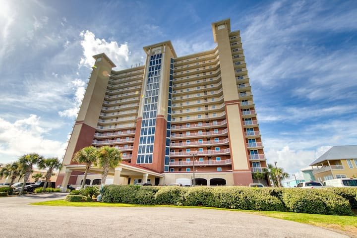 Gulf front condo w/ a shared, outdoor pool, gym, sauna, & grilling area