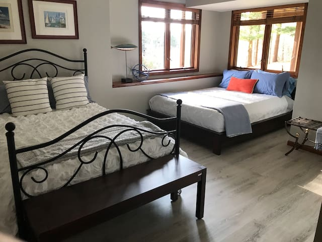 Full size iron bed and a queen platform bed nestled in the Zen corner with an amazing view.