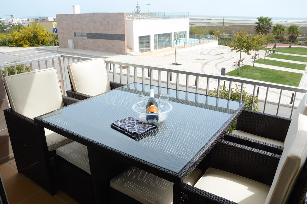 Dining on the balcony with pool and sea views