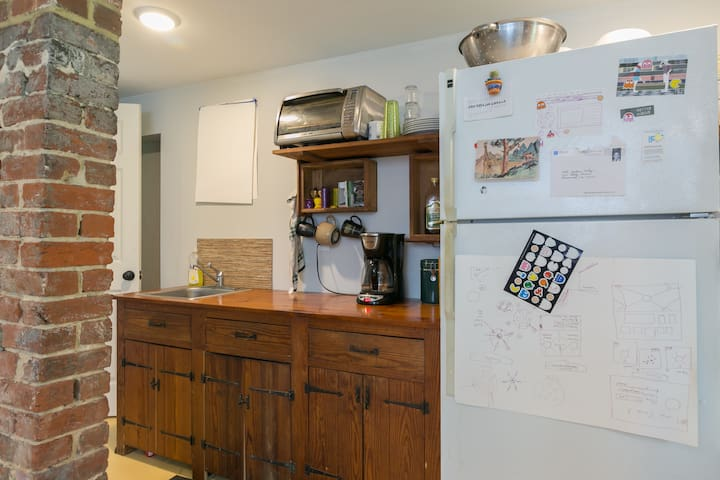 The kitchen has a two-burner electric stovetop, toaster oven (big enough for a pizza), microwave, electric frying pan, coffee maker and full fridge.