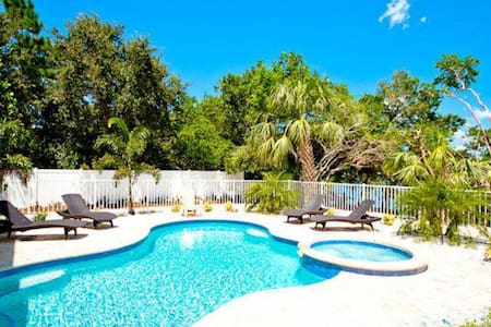 Canalfront home w/ pool, dock & lanai - 2 blocks to the beach!