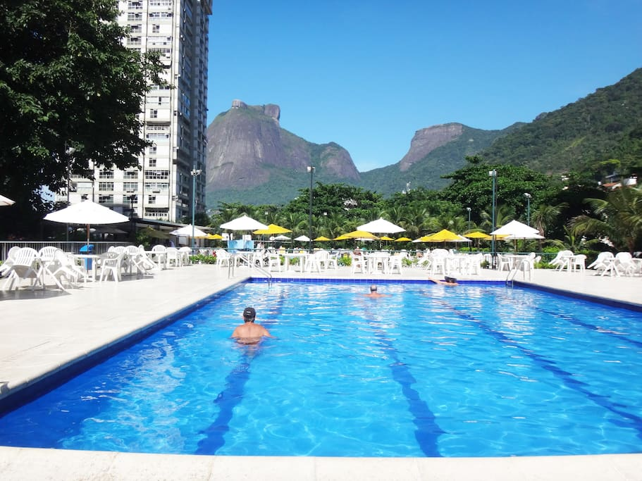 Let's escape the beach crowds? Dive into—or just lounge by—the best swimming pools in Rio! Heated pool #1. Its bright umbrellas and loungers are free