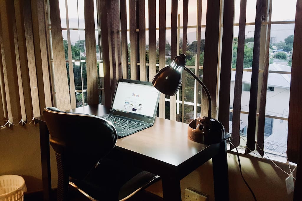Writer's desk with ergonomic chair and desk lamp.