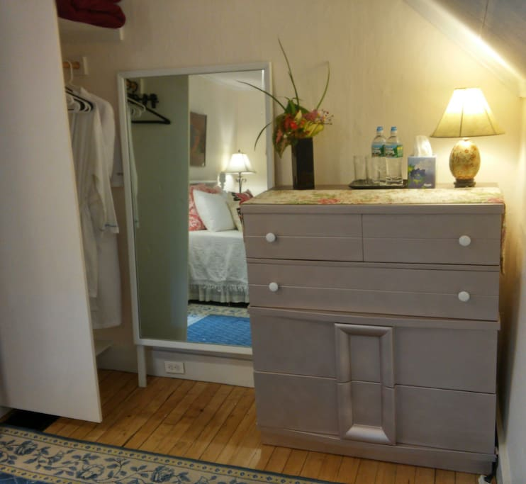 Your bedroom is complete with bathrobes in the closet. Also: iron and spray starch for special occasions; beach towels.