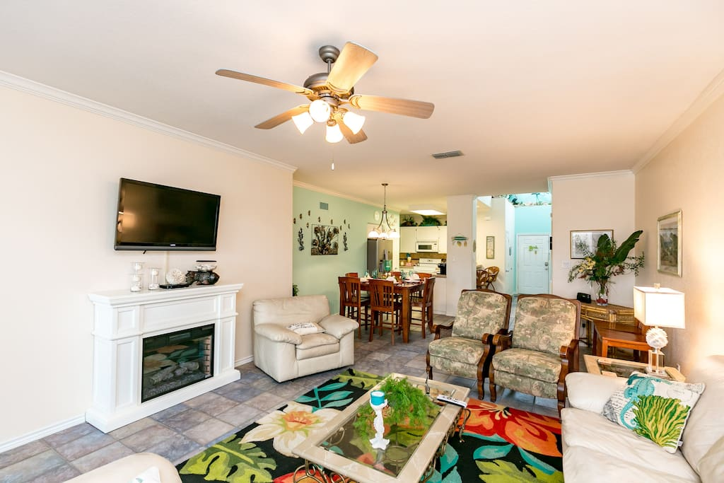 """42"""" flat-screen TV and decorative fireplace in the living room. Fireplace is not for guest use."""