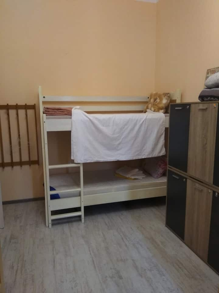 A bed in a shared 6 bed dormitory.