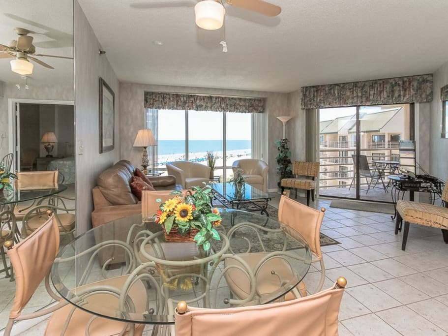 Living Room with Balcony Access and Flat Screen TV at 1501 Villamare