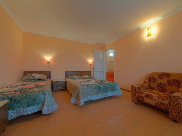 Triple room with private bathroom and extra bed.  Orhideya, guesthouse