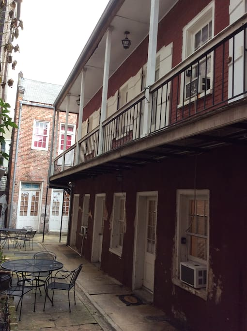 One of the hidden gems of the historic French Quarter-patio courtyard with the sound of Jazz from the street