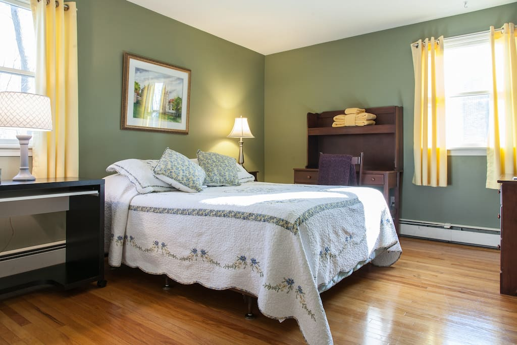 Large bedroom with comfortable queen bed is clean, bright and comfortable.
