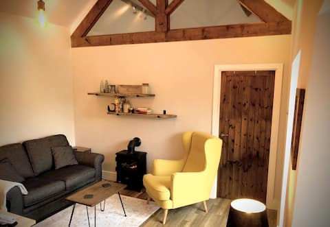 Luxury converted stone barn, town centre location.