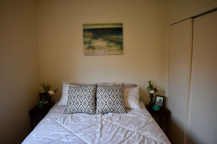 A brand new queen size bed with new bedding, lots of quality pillows, and a full closet and dresser.
