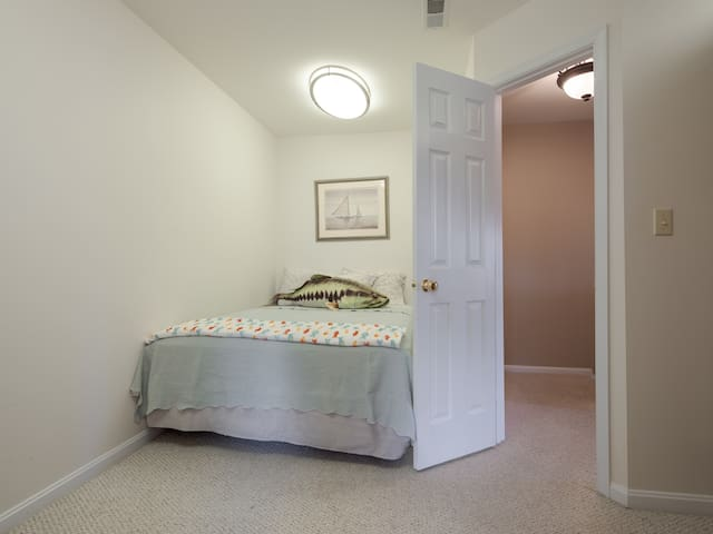 Queen bedroom at the top of the stairs.