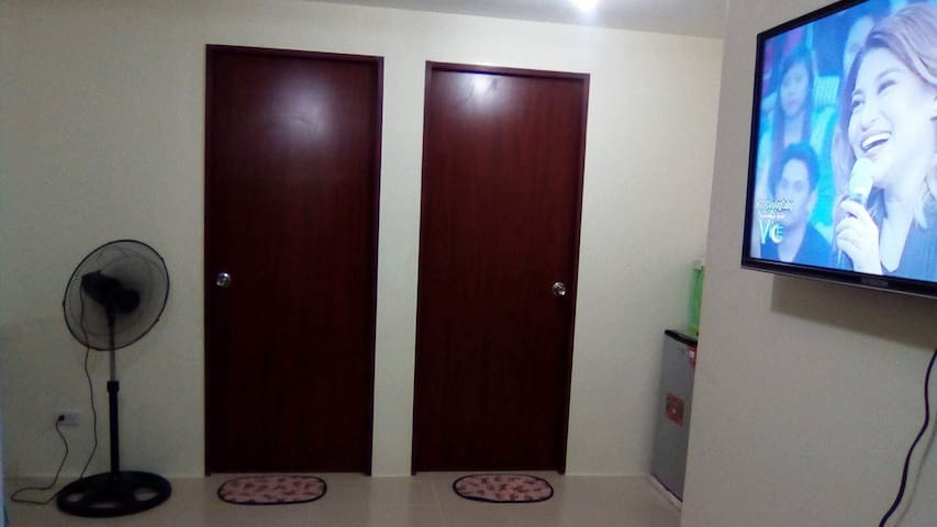 Super budget room in condo with WiFi and aircon...