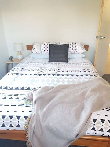 Comfortable queen bed with king sized feather & down duvet