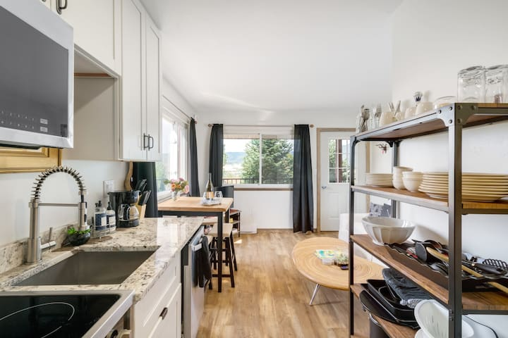 Stocked kitchen with everything you need to cook including dishwasher, microwave, oven, and refrigerator. Coffee and tea included with stay!