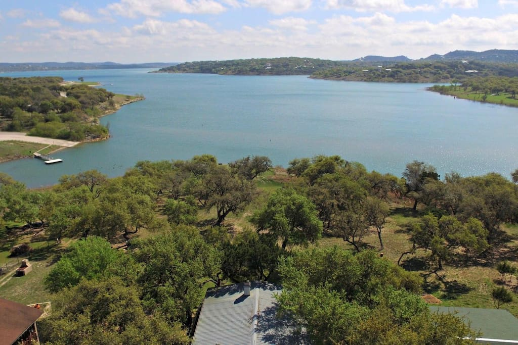 Aerial View from Above the Home - Large back yard with shady oak trees, and easy entry into the lake from the shoreline