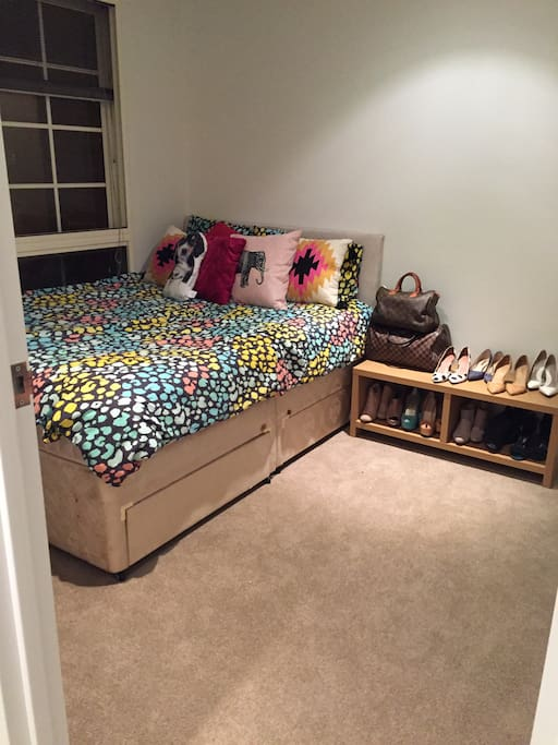 Your bedroom with big comfy double bed! Comes with built in closet and under bed storage you can use for your stay. New carpet is soft to the touch!