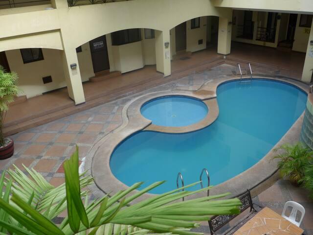 Condo with pool across Robinson's Mall  SUPERHOST