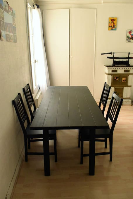A total of six chairs and a big table are available for your meals.