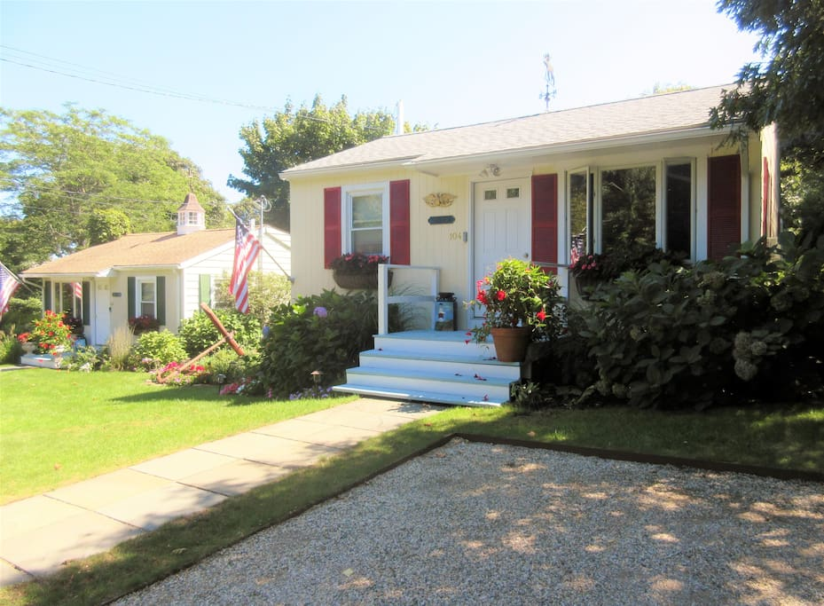 We have 2 cottages. The cottage with the red shutters is cottage 104 Adams - in this Listing.