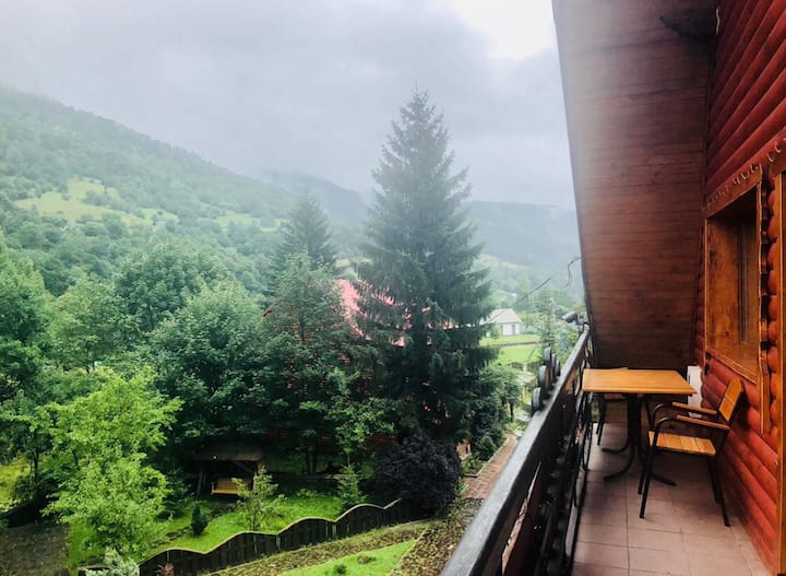 Wooden apartments with mountains view and balcony