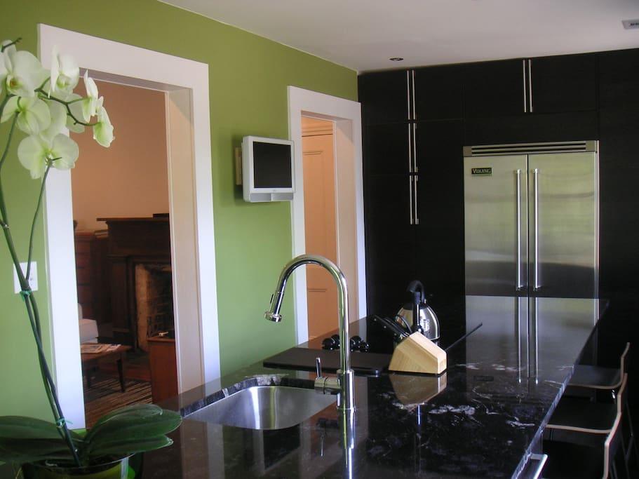 Gourmet Kitchen with Viking refrigerator, HDTV, and Granite Island