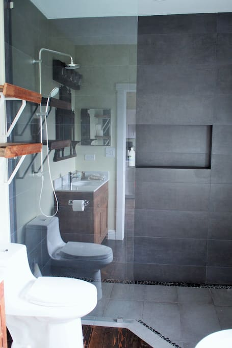 bathroom with walk-in shower, soaking tub