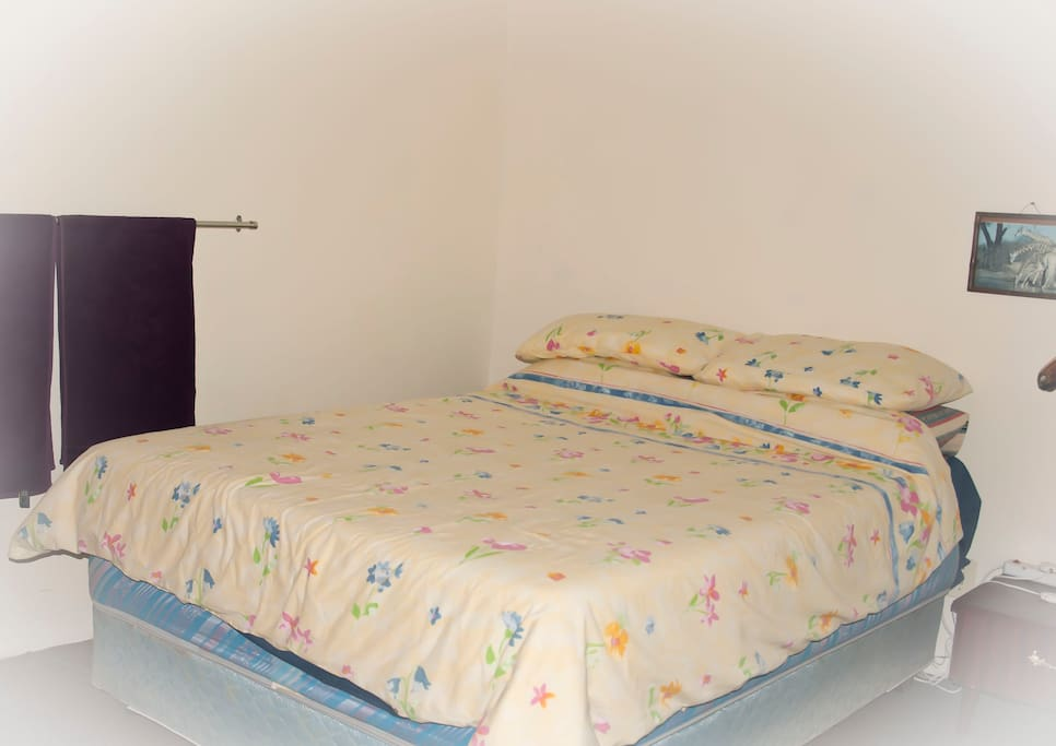 This is one of the available rooms, also a comfy double bed, lamp, plug point, chair & wardrobe.