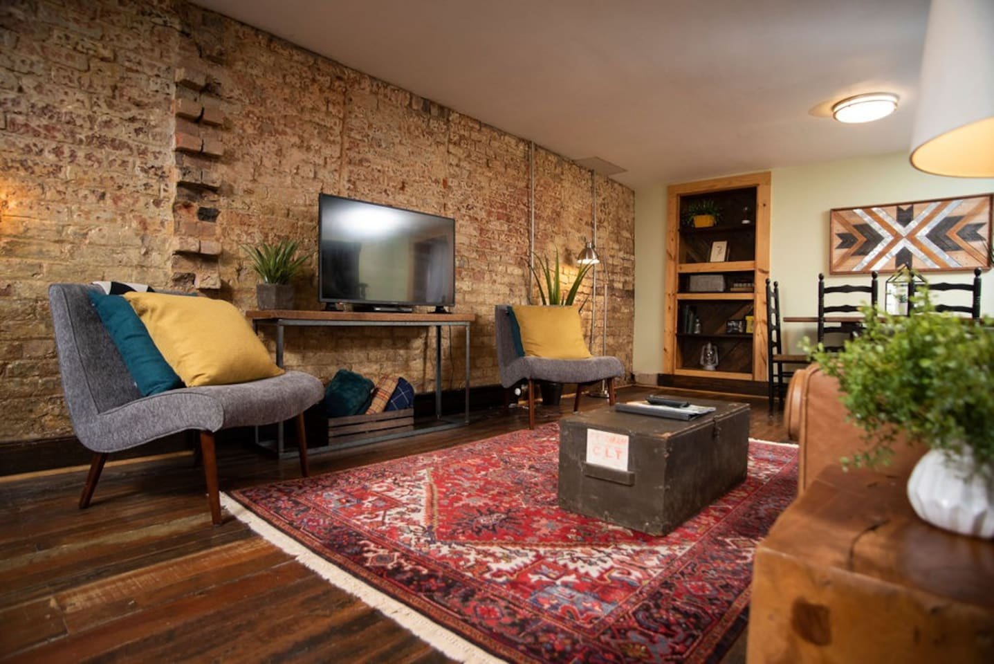 200 year old exposed brick wall in this apt full of historic rustic character