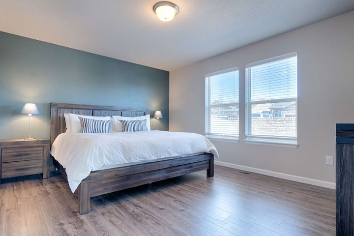King sized memory foam mattress. This master bedroom is located on the main level of the home.