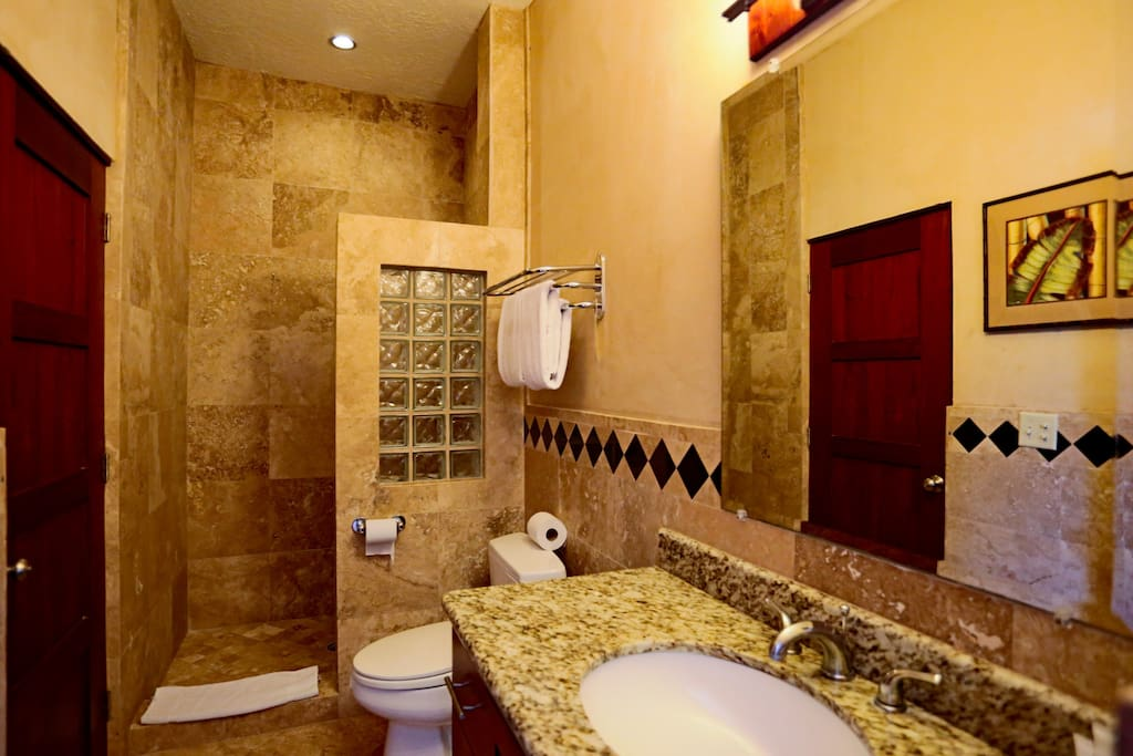 Bathroom with granite counter tops.