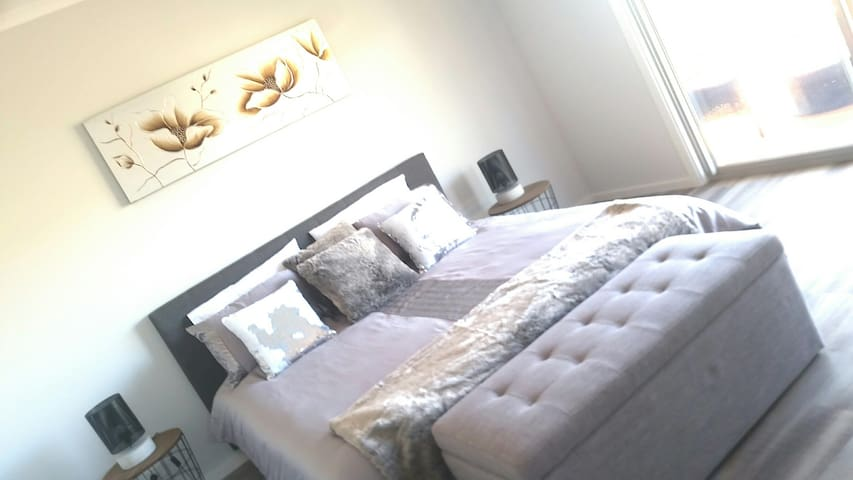 Master Bedroom with a king size bed, walk in robe and ensuite. Your own private balcony with a 2 person sitting area and comfy day bed to take in the most sensational seaside views on one side and hillside views on the other. Privacy and perfection
