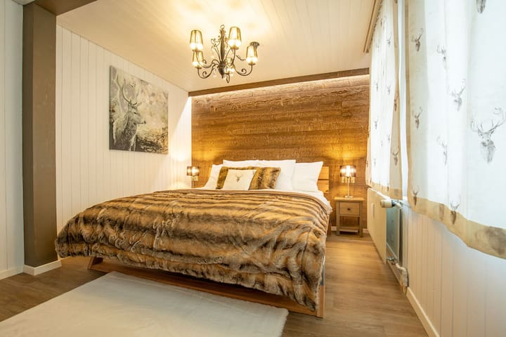 High quality furnished bedrooms in Swiss chalet style