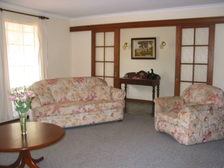 """Lounge room with double sofa bed, Bar (inc bar fridge) Gas log fire & 42"""" LCD TV, DVD  (also shows Entrance Hall)"""