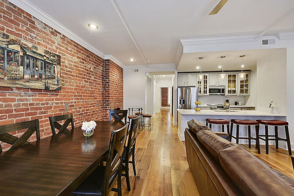 Enjoy the charm of the exposed brick walls, large open space of the living room, kitchen and dining room.