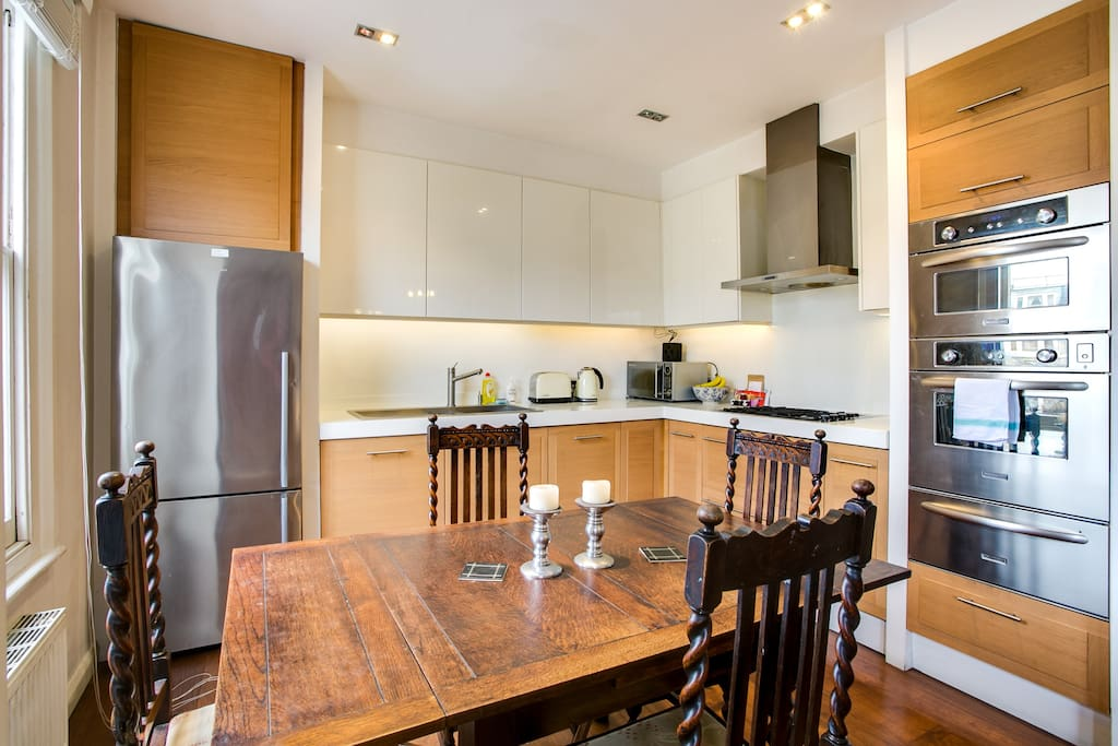 A fully-equipped kitchen with a dining table...