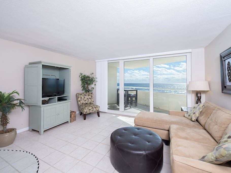 The main living area is flooded with natural light from the sliding glass doors with amazing gulf views.