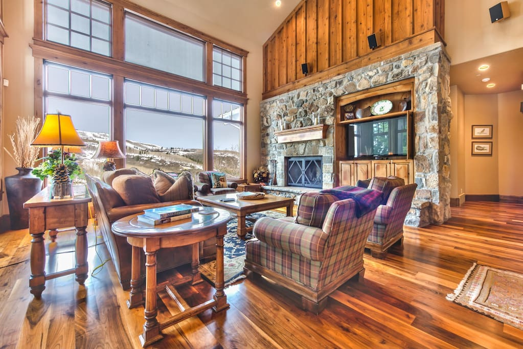 Main living room with large HD TV/DVD, private deck, and amazing views