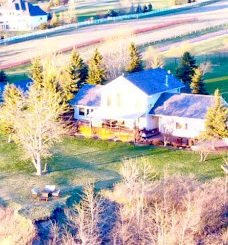 Luxurious Red Deer River Front Acreage